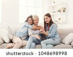 three happy young female... | Shutterstock . vector #1048698998