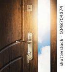 half open door with keys in... | Shutterstock . vector #1048704374