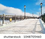 snowy bridge with lamps at blue ... | Shutterstock . vector #1048705460