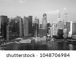 modern skyscrapers by river in... | Shutterstock . vector #1048706984