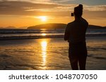 silhouette woman photographing... | Shutterstock . vector #1048707050