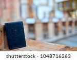 Black Holy Bible On Bench...