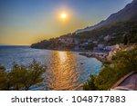 beautiful sunset over the sea ... | Shutterstock . vector #1048717883