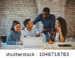 young freelance team working on ...   Shutterstock . vector #1048718783