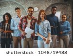young freelance team posing in... | Shutterstock . vector #1048719488