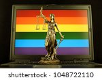 symbol of law and justice with... | Shutterstock . vector #1048722110