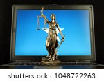 symbol of law and justice with... | Shutterstock . vector #1048722263