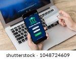 mobile online banking concept... | Shutterstock . vector #1048724609