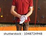 close up of climber man coating ... | Shutterstock . vector #1048724948
