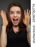 shocked and surprised girl... | Shutterstock . vector #1048730774