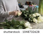 florist with bouquet of roses... | Shutterstock . vector #1048732628