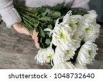 close up of flowers in hands of ... | Shutterstock . vector #1048732640