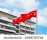 turkish flag waving in blue sky | Shutterstock . vector #1048735718