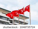turkish flags with blue sky | Shutterstock . vector #1048735724