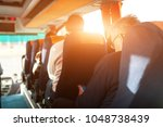 interior of bus with passengers ...   Shutterstock . vector #1048738439