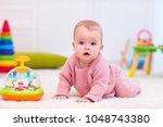 cute little baby girl crawling... | Shutterstock . vector #1048743380