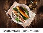 Stock photo smoked mackerel on wooden background 1048743800