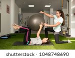 physical therapist assisting...   Shutterstock . vector #1048748690