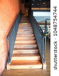 Small photo of Indoor wooden Staircase with wood handrail in the building