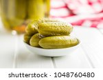 pickles in bowl. tasty... | Shutterstock . vector #1048760480