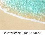 soft wave of blue ocean on... | Shutterstock . vector #1048773668