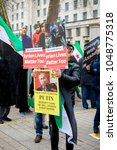 London, United Kingdom, 17th March 2018:- Anti Syrian President Assad protesters march in central London on the 7th anniversary of the start of the Syrian civil war.  - stock photo