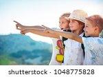 portrait of a three happy... | Shutterstock . vector #1048775828