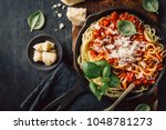 top view of frying pan filled... | Shutterstock . vector #1048781273