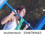 active lifestyle. slim brunette ... | Shutterstock . vector #1048784663