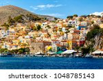 multi colored houses on the... | Shutterstock . vector #1048785143