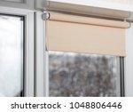 beige blackout roller blind on... | Shutterstock . vector #1048806446