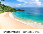 Small photo of Fernando de Noronha, Brazil. Aerial view of Sancho Beach on Fernando de Noronha Island. View without anyone on the beach. Trees and plants around.