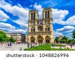 cathedral notre dame de paris... | Shutterstock . vector #1048826996