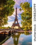 Small photo of Paris Eiffel Tower and river Seine in Paris, France. Eiffel Tower is one of the most iconic landmarks of Paris