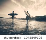 happy surfers running with surf ... | Shutterstock . vector #1048849103