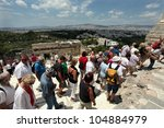 Small photo of ATHENS, GREECE - JUNE 26: Tourists in famous old city Acropolis on June 26, 2011 in Athens, Greece. Its construction began in 447 BC in the Athenian Empire. It was completed in 438 BC