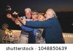 pensioner friends having fun... | Shutterstock . vector #1048850639