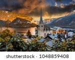 magic sunset over the halstatt. ... | Shutterstock . vector #1048859408