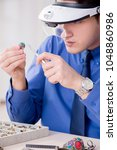 jeweler working with luxury... | Shutterstock . vector #1048860986