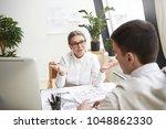 attractive mature female ceo in ... | Shutterstock . vector #1048862330