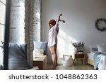 full lenght shot of attractive... | Shutterstock . vector #1048862363