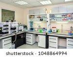 modern chemical laboratory.... | Shutterstock . vector #1048864994
