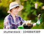 portrait of smiling beautiful... | Shutterstock . vector #1048869389