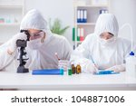 two scientists working in the... | Shutterstock . vector #1048871006