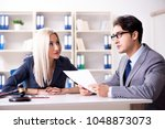lawyer discussing legal case... | Shutterstock . vector #1048873073