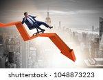 businessman sliding down on... | Shutterstock . vector #1048873223