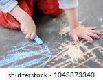 closeup photo of little kid boy ... | Shutterstock . vector #1048873340