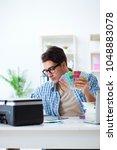 young designer choosing colours ... | Shutterstock . vector #1048883078