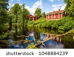 red houses in v stmanland ... | Shutterstock . vector #1048884239