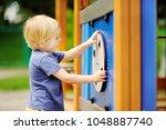little boy having fun on... | Shutterstock . vector #1048887740